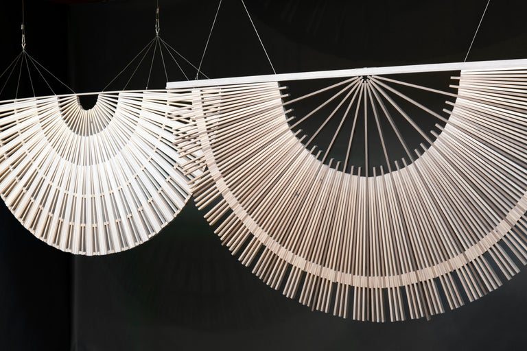 Circular screens and room dividers, spatial hanging screen, large Edition Hanging wooden circular screens and room dividers designed to add a calming and soothing tone to a space. The repetitive construction of wooden pieces, in these circular