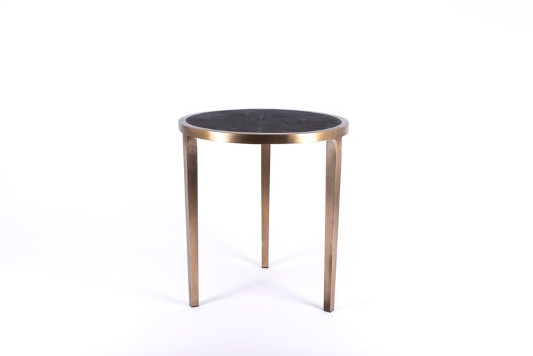The circular side table inlaid in black shagreen and bronze patina brass, is a classic piece that demonstrates the beautiful quality of Augousti pieces. The simplicity of this piece is elegant and adaptable to any space. Available in cream shagreen,