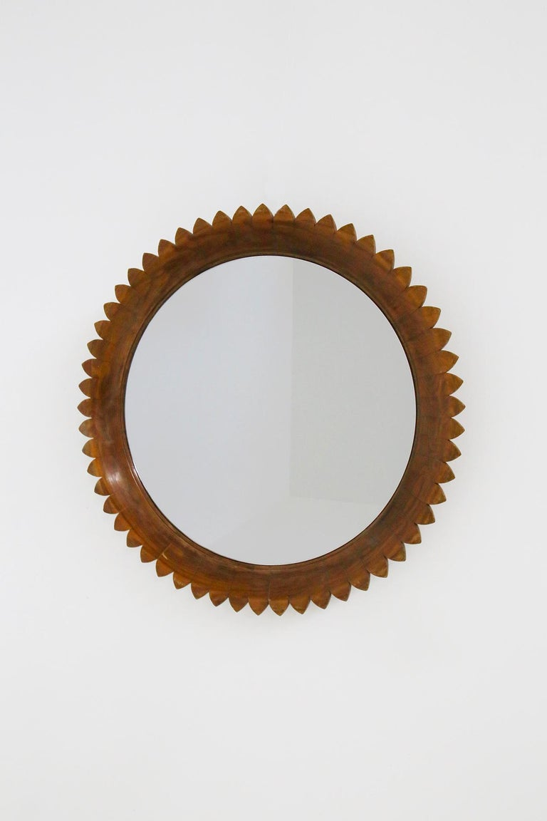 Elegant and important circular mirror made by the Italian manufacture Fratelli Marelli in 1950s. Turin.