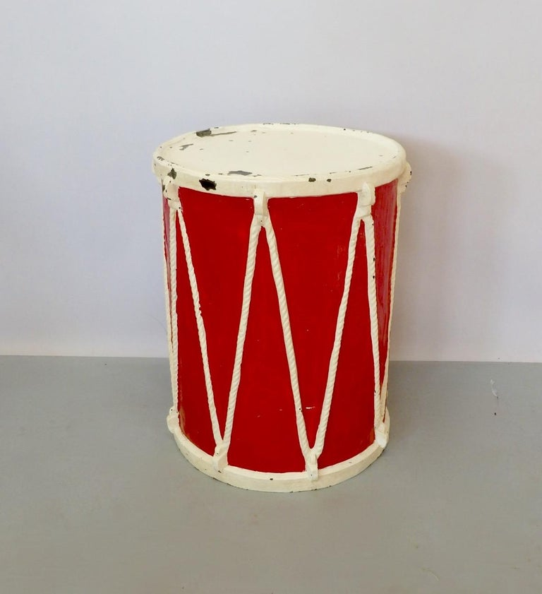 Molded fiberglass drum. Possibly circus prop or display piece.