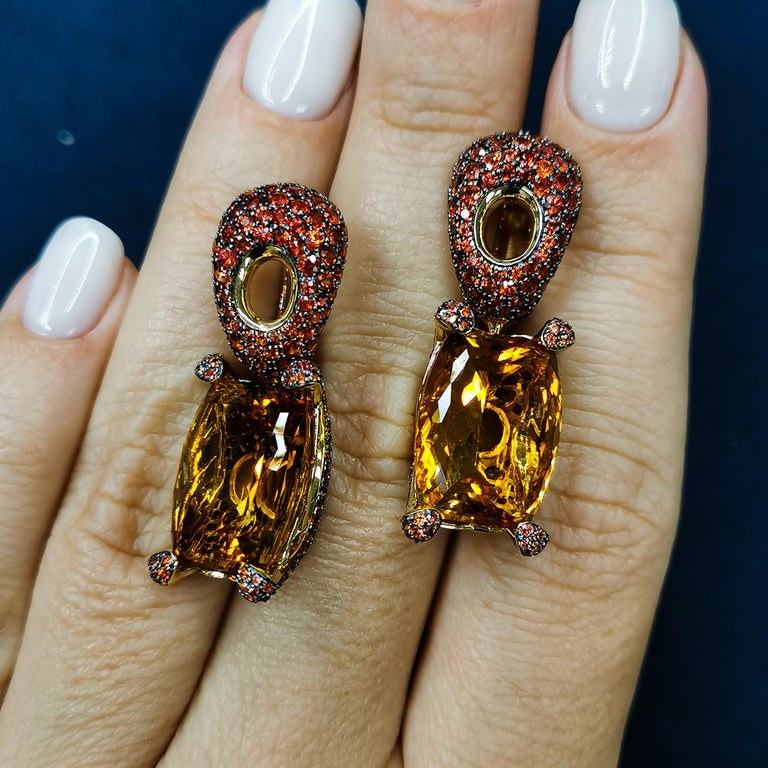 Citrine 16.74 Carat Orange Sapphires 18 Karat Yellow Gold Earrings Highlighting two 16.74 Carat Citrine and 462 Orange Sapphires weighing 5.92 Carats are mounted on an 18 Karat Gold lined with black rhodium. It displays a riveting interplay of