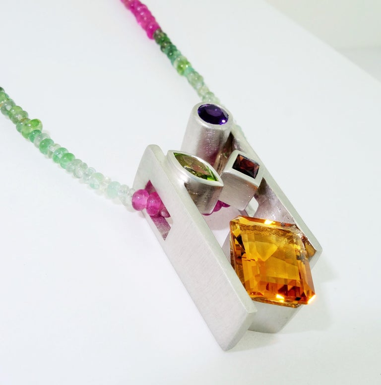 Beautiful and finely detailed Citrine, Amethyst, Peridot and Garnet Pendant set in Sterling Silver and suspended from a multi colored Tourmaline Necklace; approx. total weight of Gemstones: 4.91 Carat; The pendant is Hand crafted in Rhodium Sterling