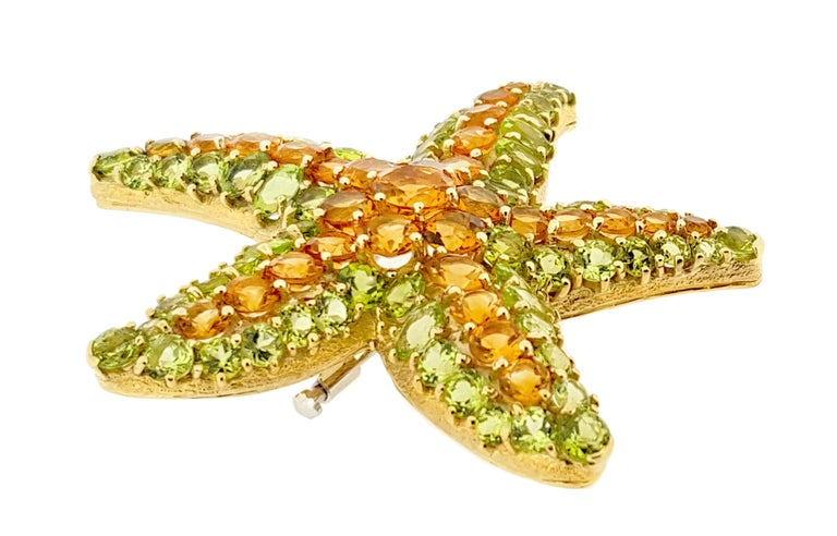 Starfish brooch, set with a center of circular-cut citrines within an outer frame of circular-cut peridots, in 18k yellow gold. Citrines weighing approximately 7.00 total carats and peridots weighing approximately 10.00 total carats. 2.75