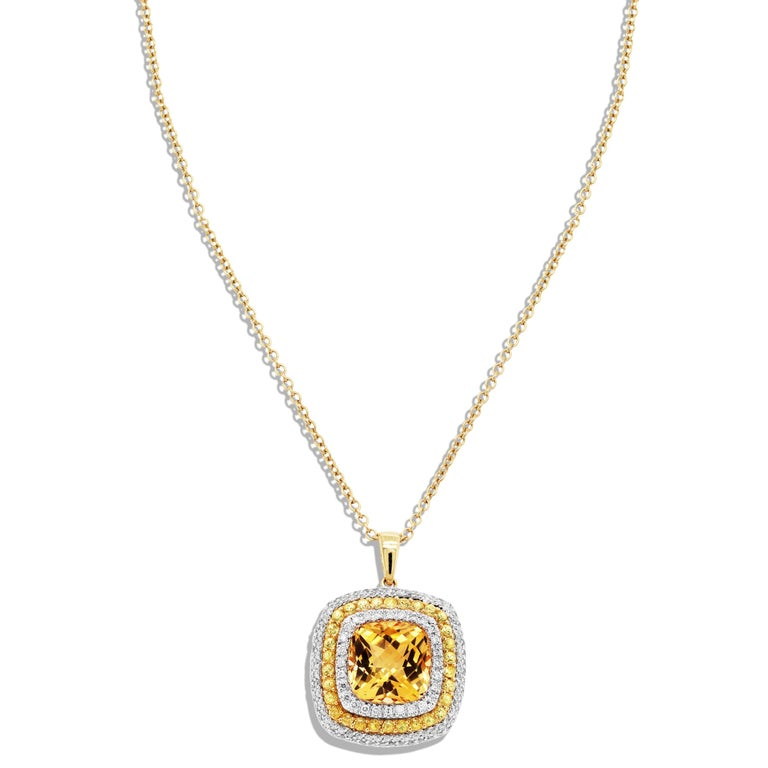 18K Yellow Gold Pendant with Citrine center surrounded by Yellow Sapphires and Diamonds  0.80 carat apprx. diamonds total weight 0.35 carat apprx. yellow sapphires total weight  Apprx. 5 carat Citrine center  Chain is 16 inches in length and uses a