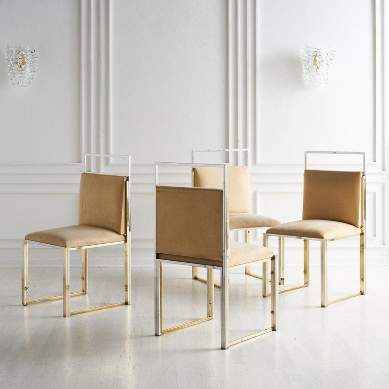 A set of 4 brass and chrome dining chairs by Cittone Oggi. Clean, modern lines make these an easy and gorgeous fit. These chairs have a matching dining table, viewed here.
