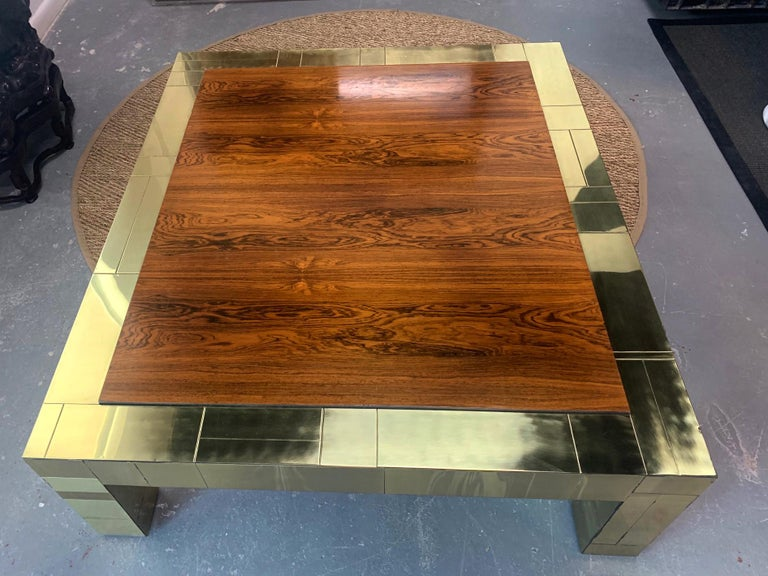 A large brass patchwork cityscape coffee table in contrast with a rather unusual Brazilian rosewood top. A very generous size with striking visual impact. This is a custom pieces executed circa 1975 by Paul Evans for Directional.