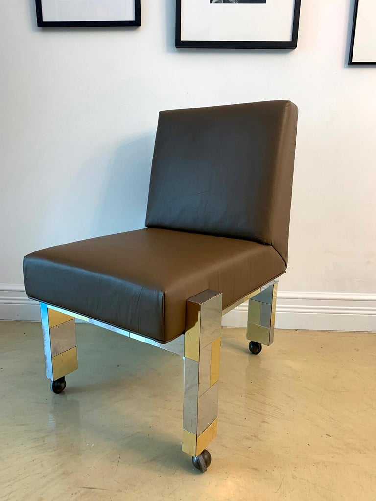 A wonderful cityscape chair in chrome and brass patchwork made by Paul Evans studio for Directional, circa 1974. The chair is supported by exposed legs that extend to the back, giving an interesting profile from the all sides, especially with the