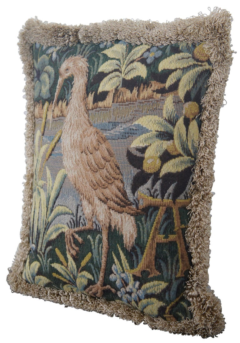 Medieval style, down filled, embroidered throw pillow with velour back and gold fringe, featuring a heron or crane at the edge of a lake with the capital letter A, made in France for CJC of St Simons Island, GA.