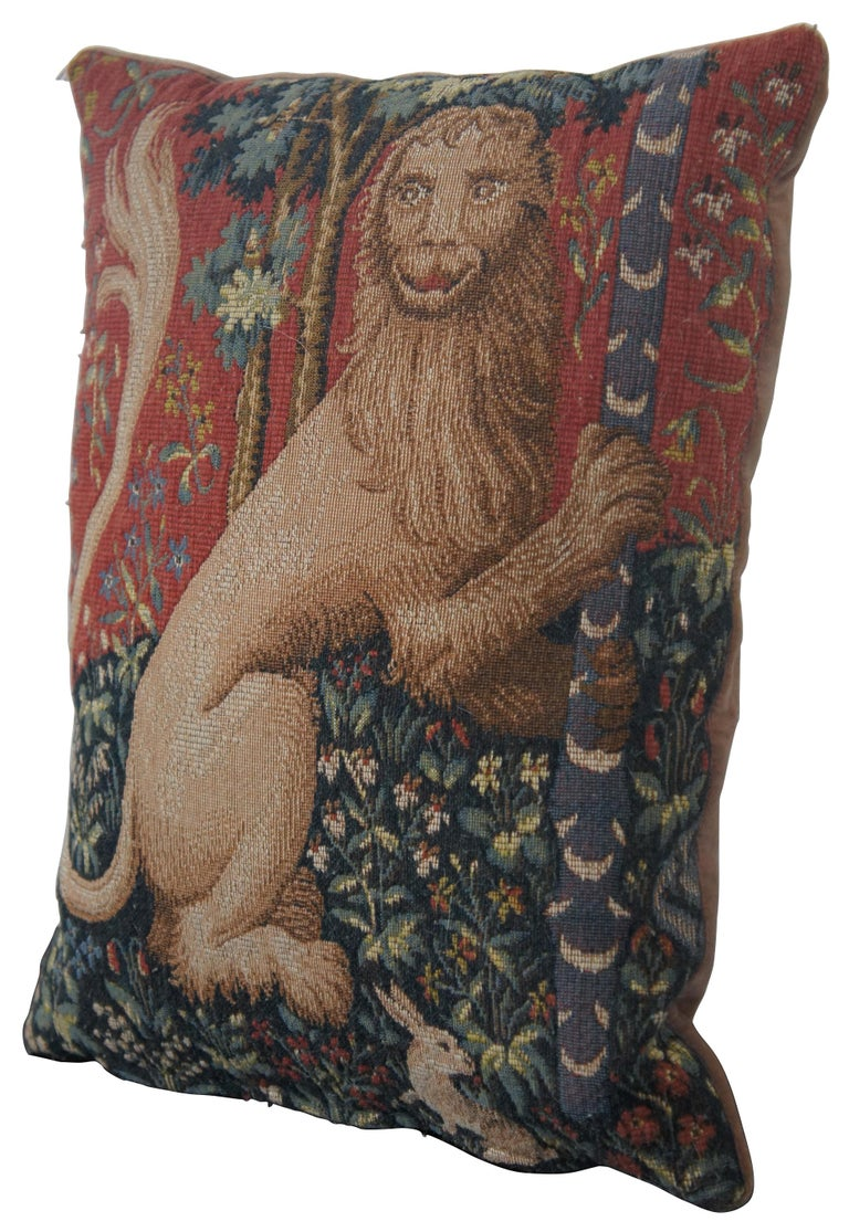 Medieval style, down filled, embroidered throw pillow with velour back featuring a heraldic lion and rabbits among trees and flowers, made in France for CJC of St Simons Island, GA.