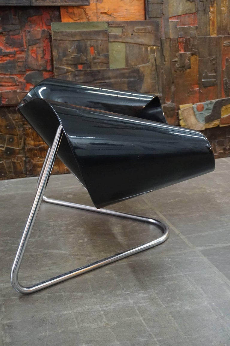 Designed by Franca Stagi and Cesare Leonardi for Bernini, Italy, 1961. Black lacquered fiberglass frame on chromed tubular steel frame.