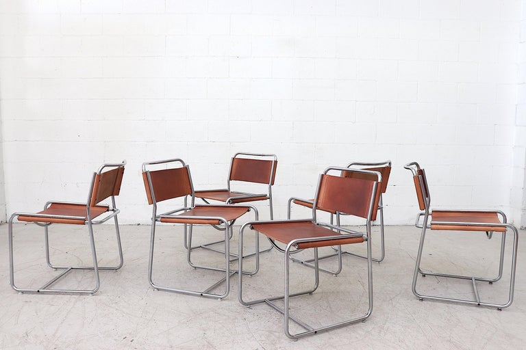 Rare set of 6 Claire Bataille and Paul Ibens Model SE18 leather dining chairs for 'T spectrum, Netherlands, 1971. Nickel-plated tubular steel frames with newly made period correct saddle leather seating including white cotton stitching. Simple but