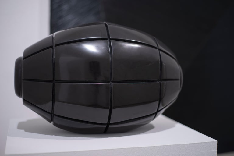 Claire Lieberman shows incredible dedication and skill with her hand sculpted black Belgian marble works. Each sculpture is unique, made by hand and brought to a smooth polish.  This work has crisp, deep lines that punctuate each rectangular form