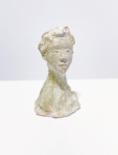 Small bust in green by Claire McArdle. Terra cotta sculpture.