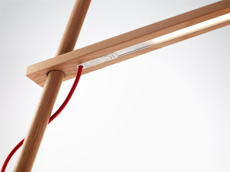 Designed for simplicity and engineered for sustainability, Clamp combines the beauty of wood with the brilliance of LED technology. Clamp is comprised of 3 main components that work together to provide infinite adjustment, while focusing warm,