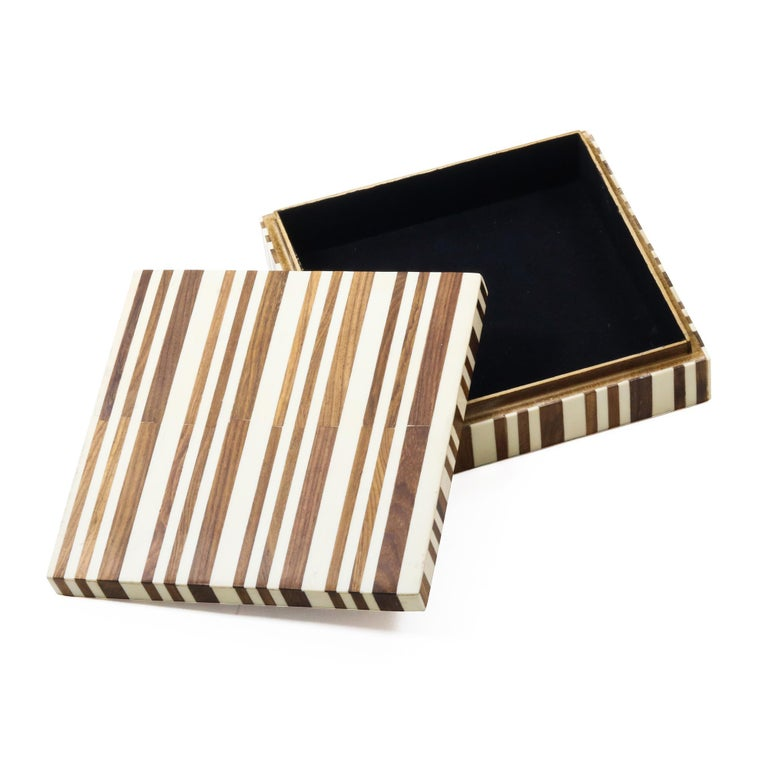 A square brown and cream decorative resin box featuring a striped pattern of varying thicknesses.