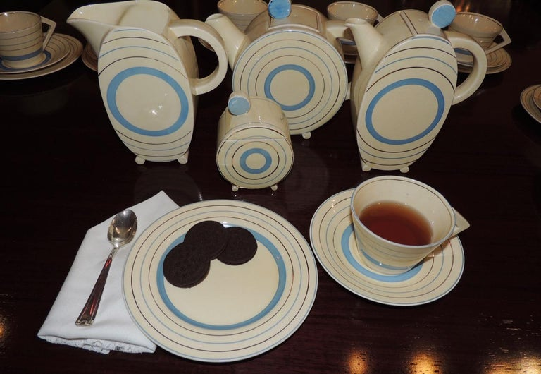This Clarice Cliff tea set for eight 28 pieces total is so rare and so deco. More streamlined and elegant than the playful Bizarre Ware that she is known for, this set in the Bonjour shape and target pattern for the Newport Pottery Company in 1931.