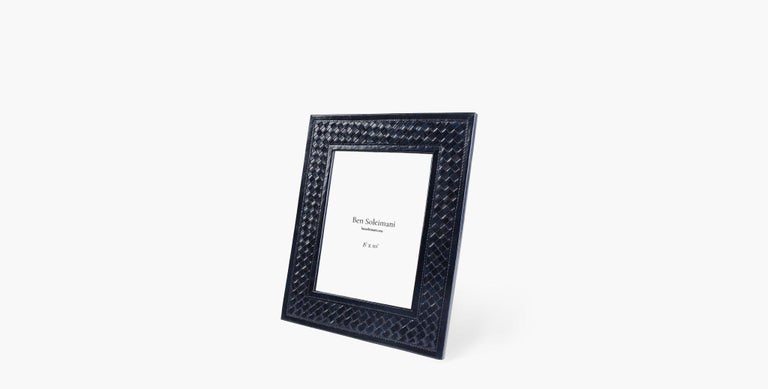 A highly tactile design via woven supple leather, our Clarion Picture Frame acts as a luxurious and functional decorative accent for your space.   Basketweave leather design Imported