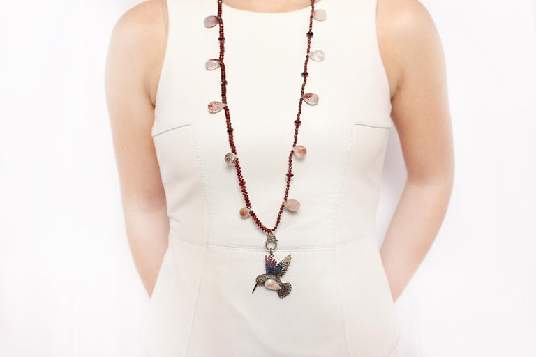 Garnet and Rubelite Necklace with Diamond Clasp adorned with Pearl and Diamond on Silver Hummingbird Pendant   Length: 36 inches