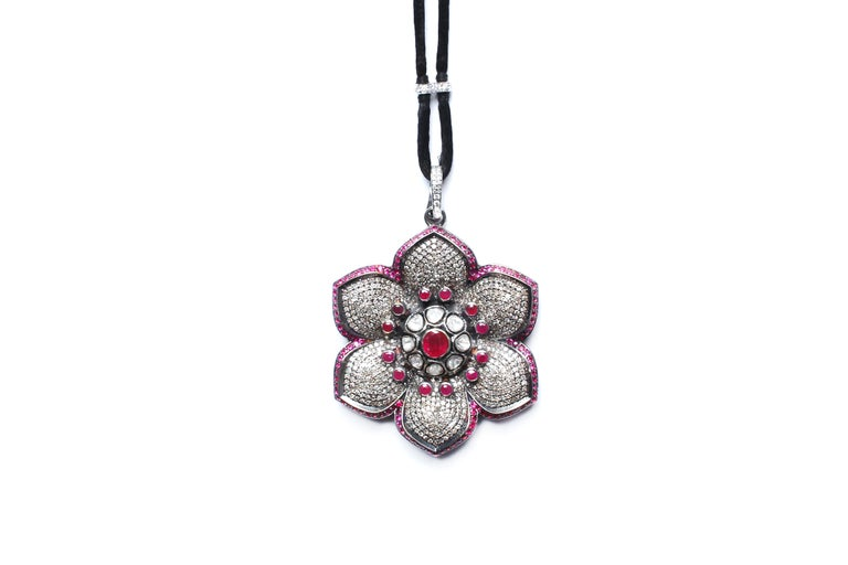 Ruby, diamond, rose cut diamond, and silver flower pendant. Has a separate removable diamond and silver clasp.   Adjustable suede, and diamond cord.