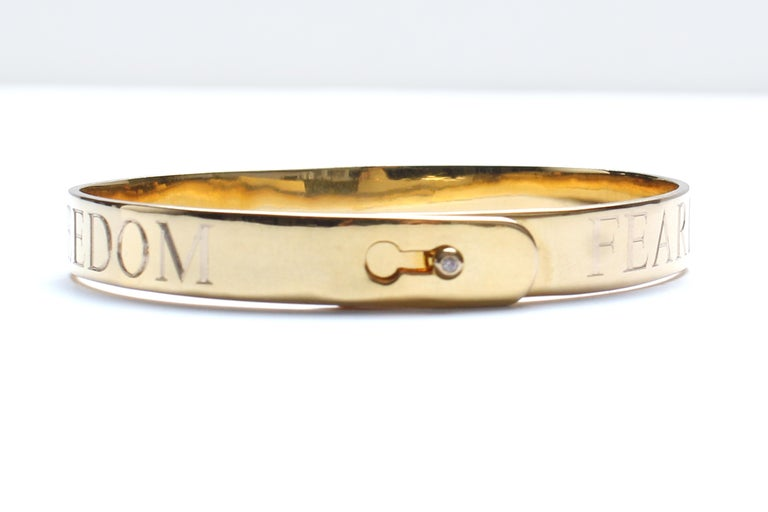 Perfect gift for the one you love!  14k gold, diamond bangle.   Dimensions: 2 2/4