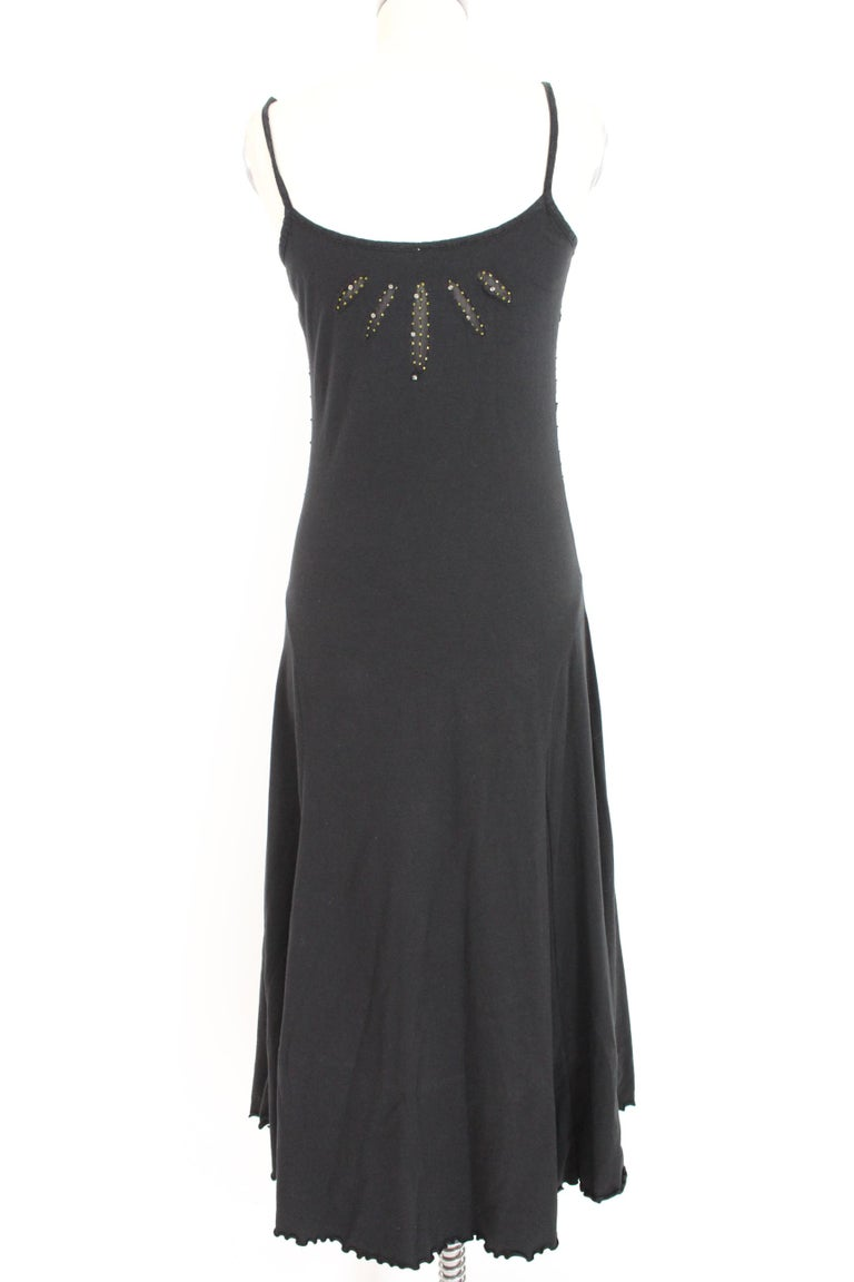 Class Roberto Cavalli vintage 90s dress. Long dress, flared skirt. Bodice with straps, sequin applications and transparencies. Black colour. Stretch cotton. Made in Italy. Excellent vintage conditions.  Size: 44 It 10 Us 12 Uk  Shoulders: 44