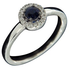 Classic 18 Karat White Gold, Blue Sapphire, and Diamond Ring
