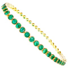 "Classic 19.2 Karat Yellow Gold ""Tennis"" Bracelet with Emeralds"