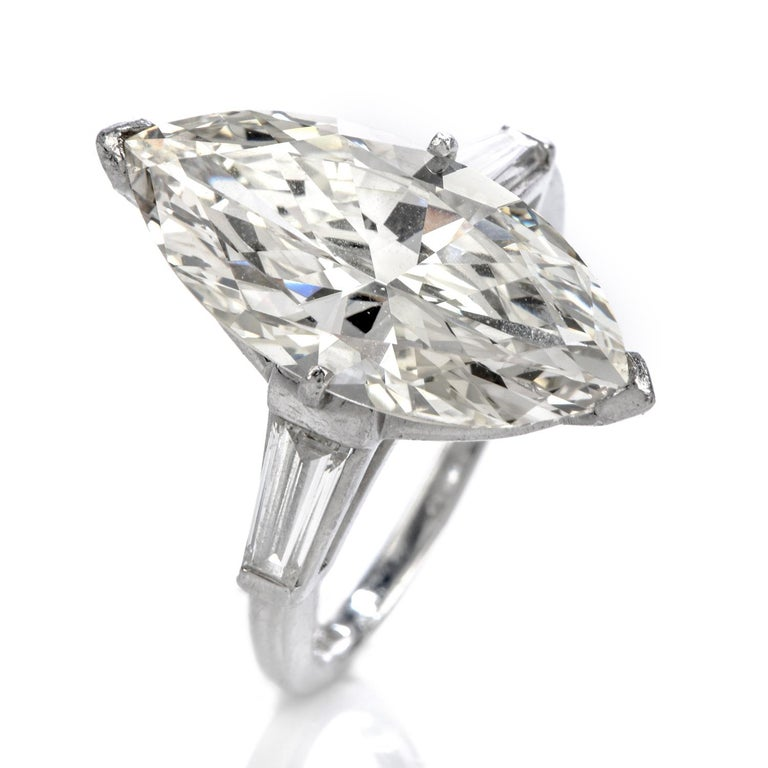 Beloved with this vast Marquise Engagement Ring!  This Magnificent diamond engagement ring is crafted in solid Platinum 900.  Displaying a Center 5.94 Carats Marquise cut Diamond , Kcolor,VS1clarity. Embellished by two Tapered Baguette Cut