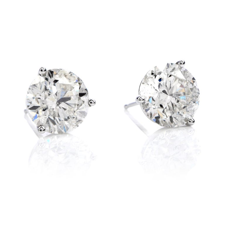 Classic Studs.  These must-have earrings are crafted in 14K gold  and contain 2 round faceted naturaldiamonds  weighing cumulatively approx. 6.13carats in totaland are graded at H-I color and Very nice I1-I2 clarity with natural markings