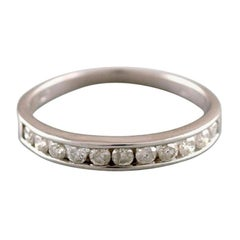 Classic Alliance Ring in 10 Carat White Gold with Numerous Diamonds