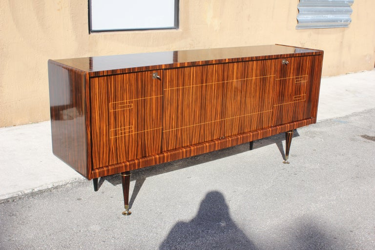 French Art Deco Style exotic Macassar ebony sideboard / buffet/bar, circa 1940s. The sideboard are in very good condition, with 4 shelves adjustable, and bar section, you can remove all the shelves if you need more space, beautiful bronze hardware