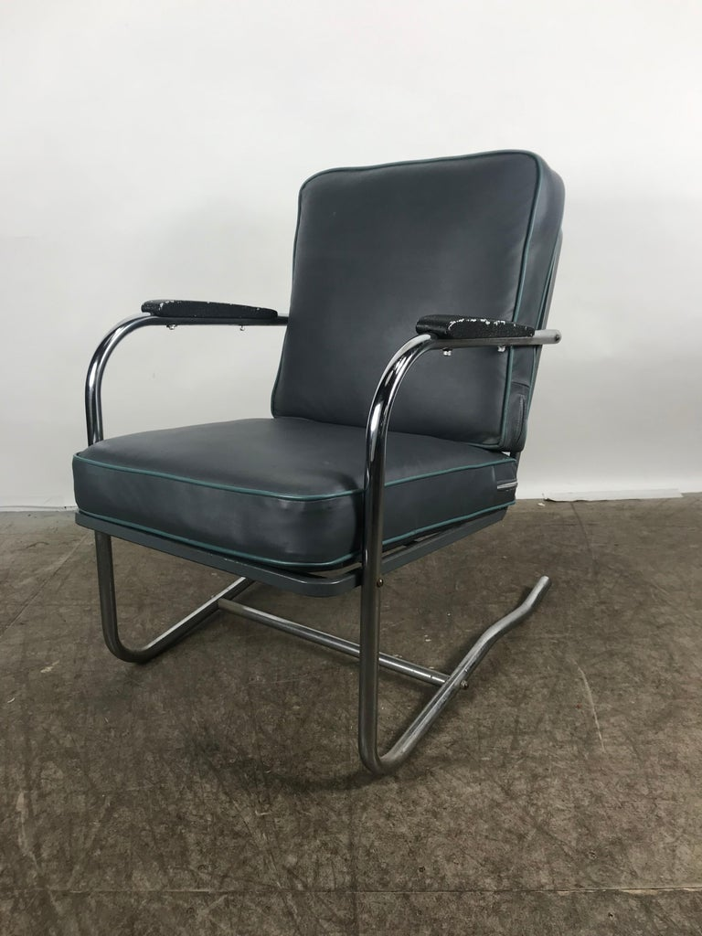 Classic Art Deco, Bauhaus tubular chrome lounge chair. Cantilever chrome frame, recently upholstered in a blue Naugahyde fabric with baby blue piping, extremely comfortable.