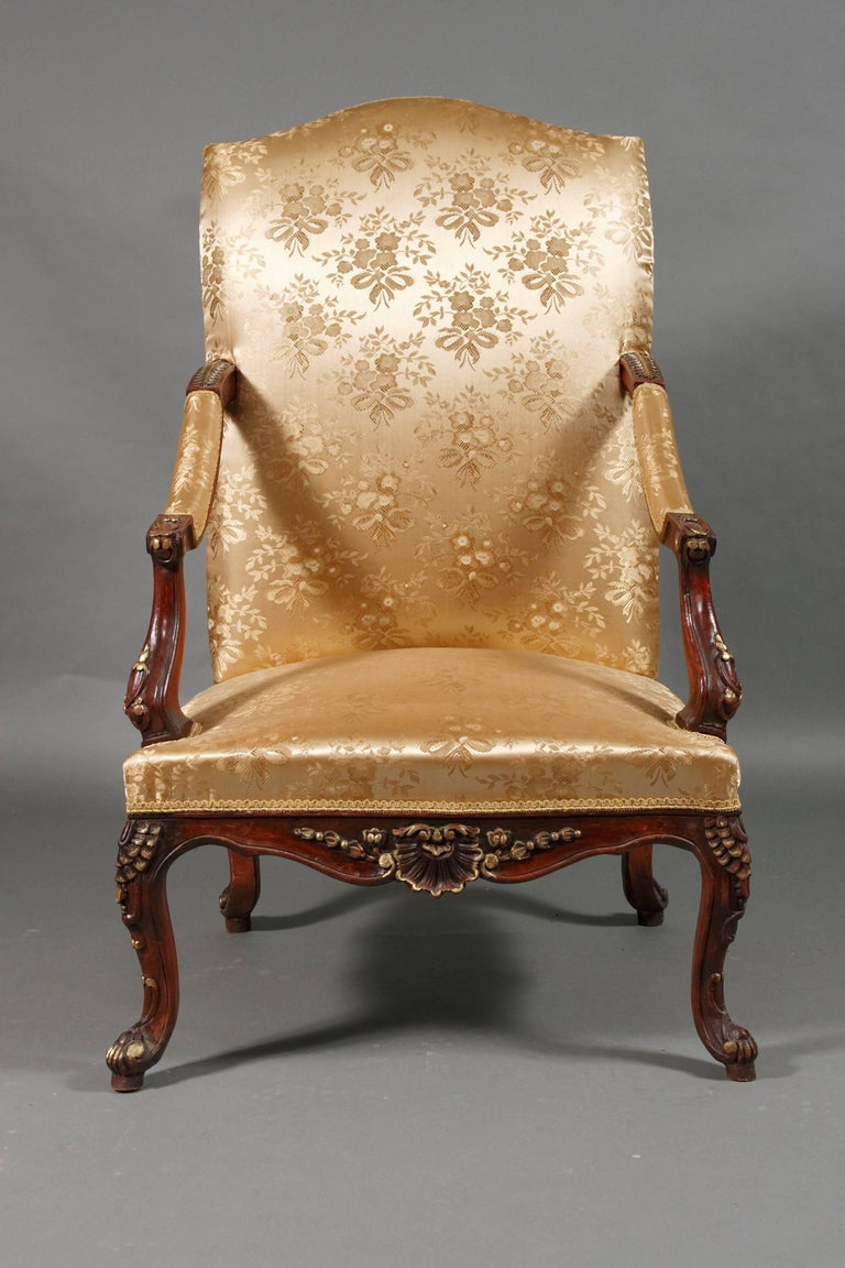 Curved frame, rolled armrests. Legs and armrests made of solid beech wood with beautiful foliage carvings. On volute-like, curly legs. High backrest, bent top. The seat and backrest are finished with a classic upholstery. The fabric cover is in a