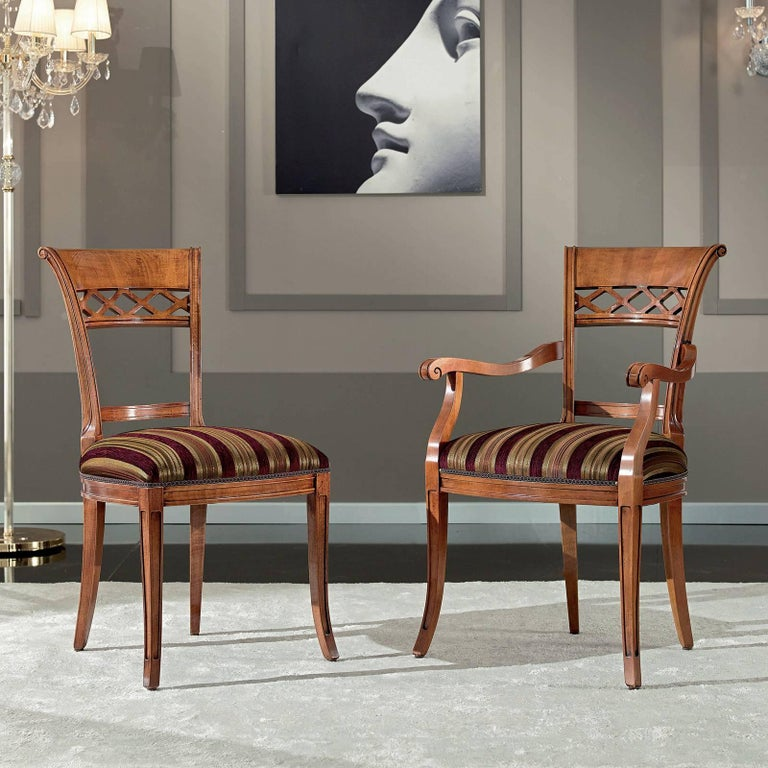 Fashioned entirely of wood, this classic chair will infuse timeless sophistication into any decor. The distinctive backrest is characterized by a bold top rail half solid and the other with a hallowed out