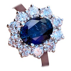 Classic Blue Sapphire and Diamond Cluster Engagement Ring