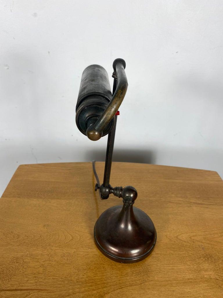 Classic bronze antique piano lamp, fully adjustable.