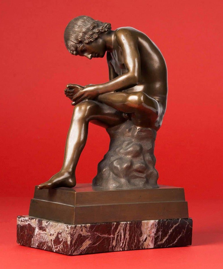 Classic bronze statue depicting a young boy picking a thorn from his foot. The original statue is called 'Spinario' and dates from the first century B.C. This copy is from circa 1900, it is signed 'B. Boschetti Roma'. Bosschetti is a bronze caster