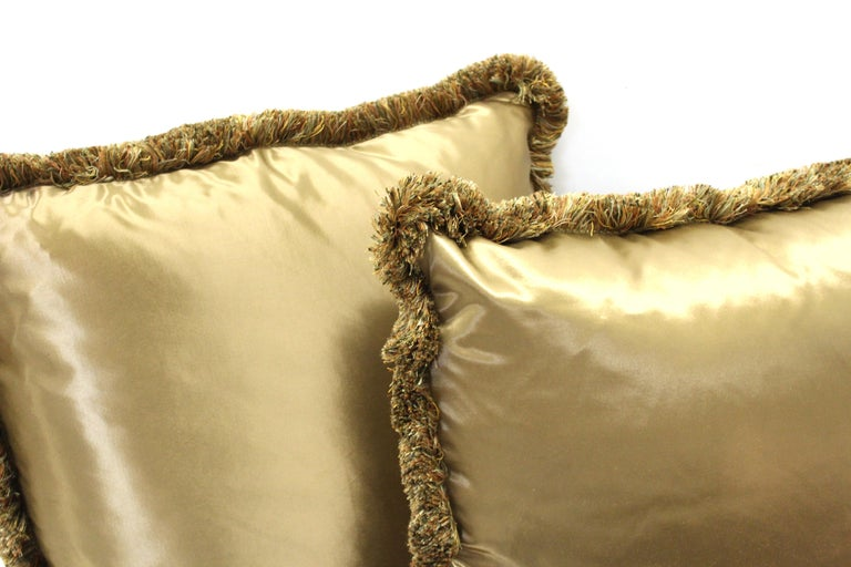 Vintage pair of large satin drawing room pillows in champagne color with matching fringe.