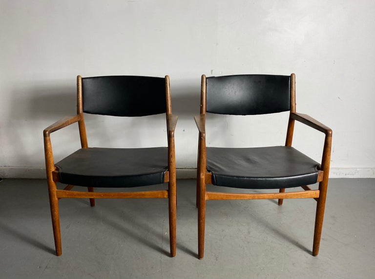Classic Danish armchairs in solid oak by Knud Andersen, J.C.A. Jensen, Aarhus Denmark, nice original condition, retains original finish, patina, extremely comfortable, solid, sturdy construction.