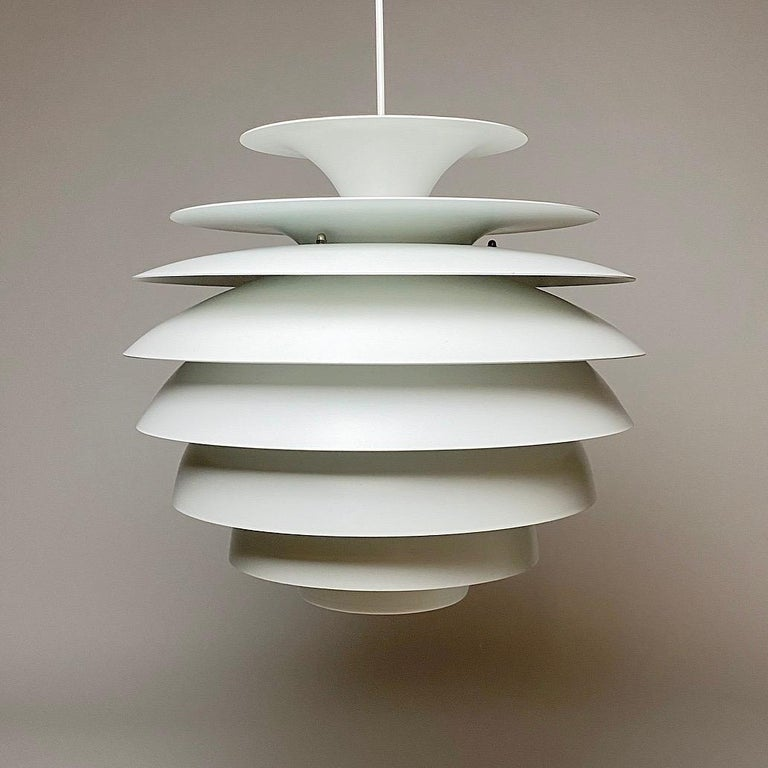 """Beautiful Classic Danish ceiling light Barcelona by Bent Karlby.  Eight shades with a beautiful top shade. All white lacquer in excellent condition.  Light source: E27 / E26 Edison screw fitting with new white cord.  Size: 40cm / 15.7"""""""