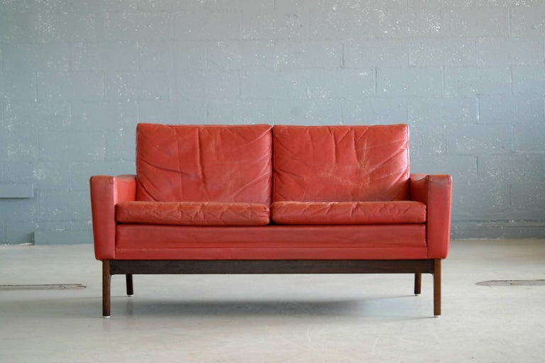 classic danish mid century modern sofa in red leather and rosewood