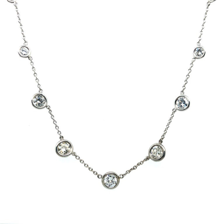 Delicate diamond necklace crafted in white gold 18 karat. Fine anchor chain interrupted by 9 brilliant-cut diamonds totalling 2.75 ct of G/8H/I colour and vs clarity. The bezel set diamonds range from 0.10 ct to 0.48 ct in individual weights. Chain