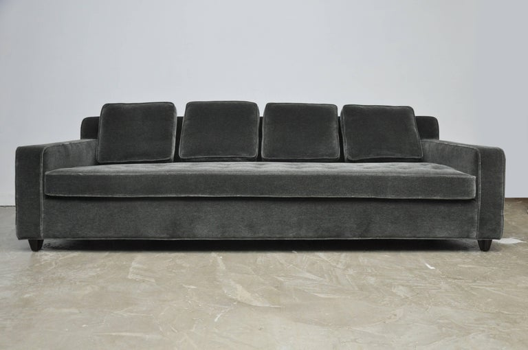 Early model sofa by Edward Worley for Dunbar. Classic design, fully restored in charcoal mohair. Beautiful espresso finished feet, circa 1950.