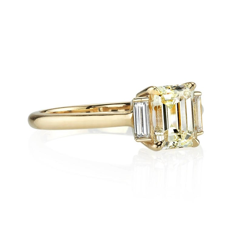 1.14ct I/VS1 EGL certified Emerald cut diamond set in a handcrafted 18k yellow gold mounting. Classic and chic,  this three stone ring is flanked with 0.24ctw Baguette accents.