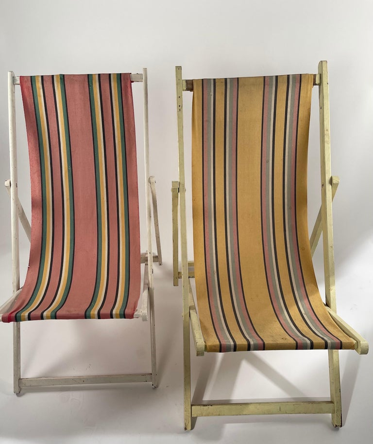 Classic striped canvas foldable chairs. Some staining but have a wonderfully vintage garden look and feel.