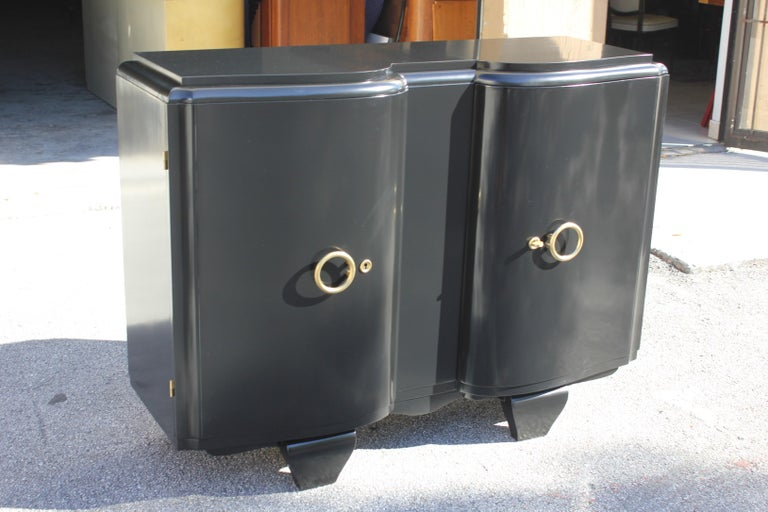 Classic French Art Deco sideboard, credenza or buffet made of mahogany, the mahogany wood has been ebonized and finished with a French polished high luster, the back of the sideboard are finish too, The sideboard or buffet has two doors, with