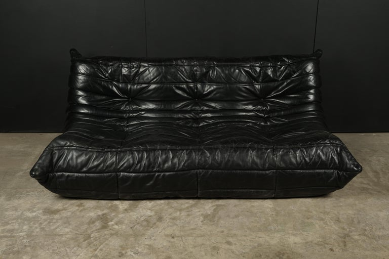 Classic French vintage leather Togo sofa by Michel Ducaroy for Ligne Roset. Original black leather upholstery. Label has been cut, but partly remains. Very comfortable.