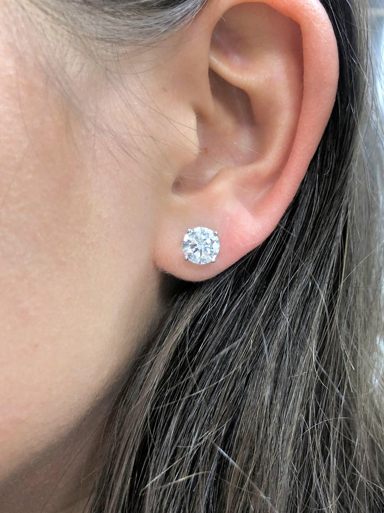 This is an ideal diamond studs. The total diamond weight is 4 carats, GIA Certified, J color SI2 in clarity    Set in 18K White Gold, 4 prong Setting.