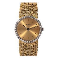 Classic Gold Piaget Watch with Champagne Dial and Diamond Bezel
