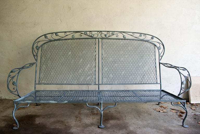 Classic handcrafted high quality wrought iron garden settee by Salterini. Very solid and beautifully made.